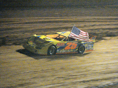 Shane Clanton carries the flag during the National Anthem.