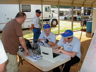 Kevin Bowman and Alex Cummings check in the drivers for the Carolina Clash