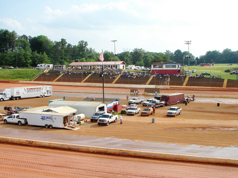 the infield has a tech building and food stand in the middle