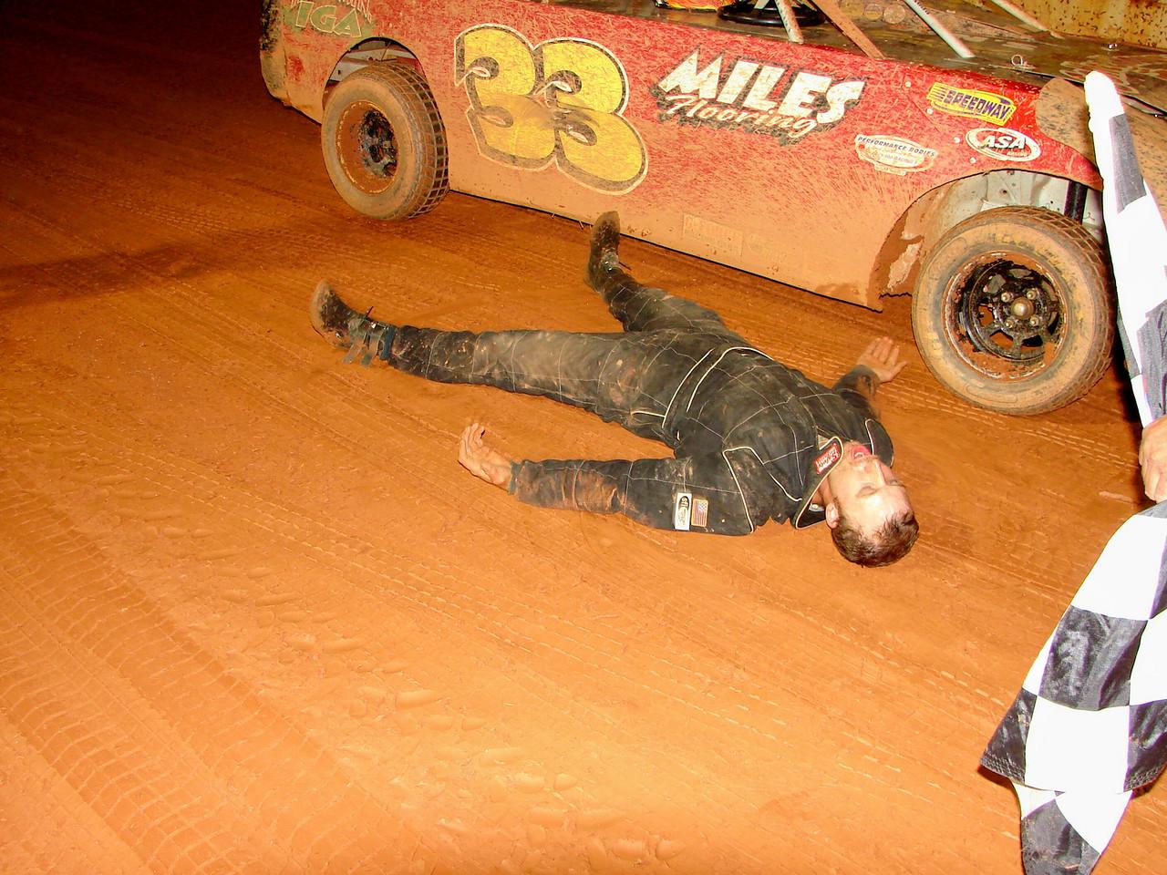 """winner Robbie Brown doing """"dirt angels"""" in victory lane"""
