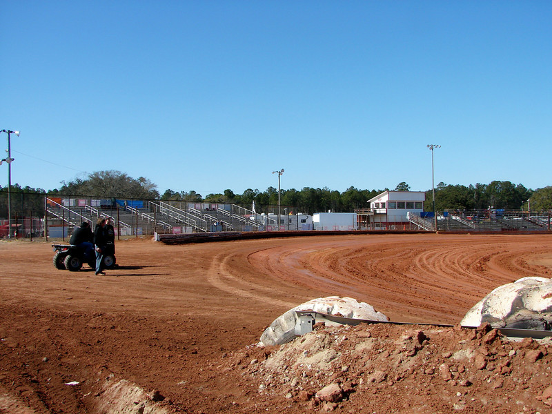 the turn one track entrance and pit stands at Golden Isle Speedway, Georgia