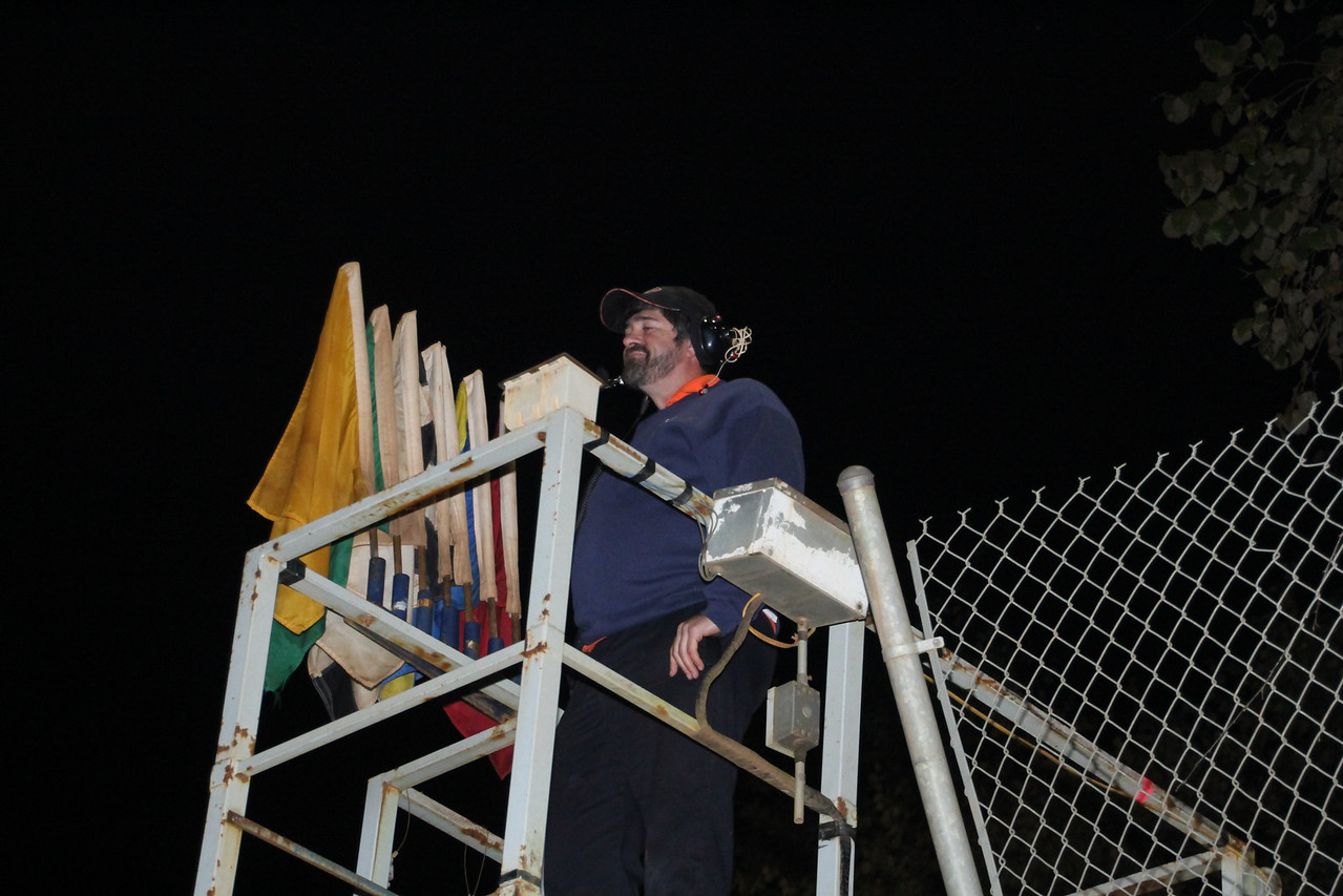 track manager Marion Limbaugh checks the crowd from his old home... the flag stand