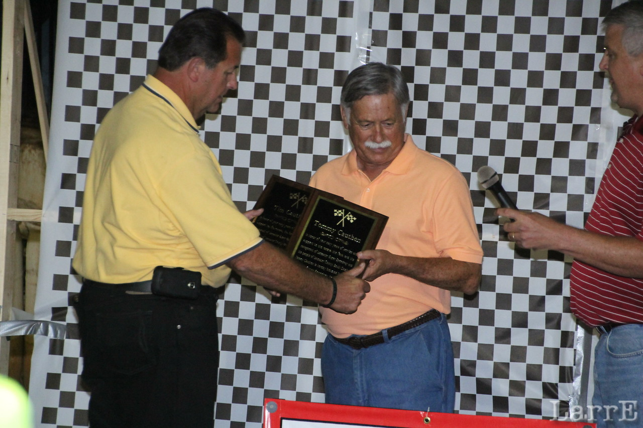 Lancaster Speedway owner Doug McManus, hands Cauthen the plaques for Cauthen and his brother Cauthen