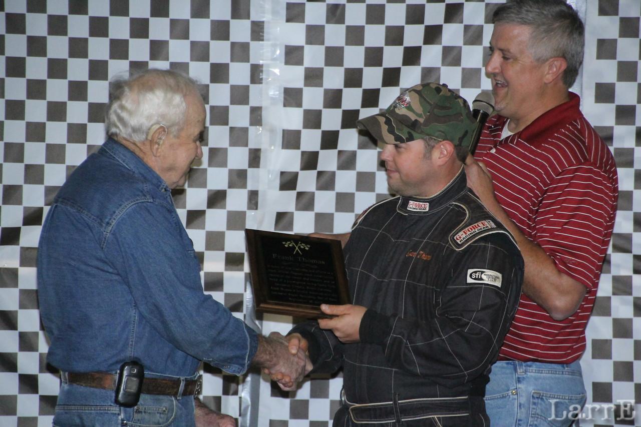 Frank Thomas receives his trophy from grandson Evan Thomas