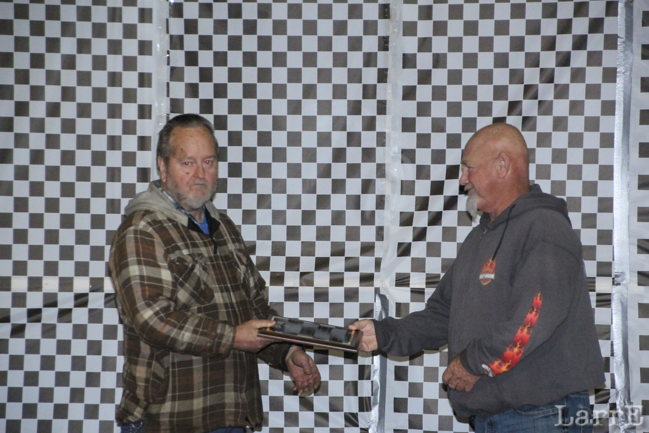Wayne Webster receives his 2013 Hall of Fame plaque from Kenny Polston.