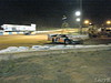A late model pulls off the track at the backstretch pit entrance