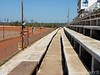 Concrete seating..you may want to bring a stadium seat or cusion.