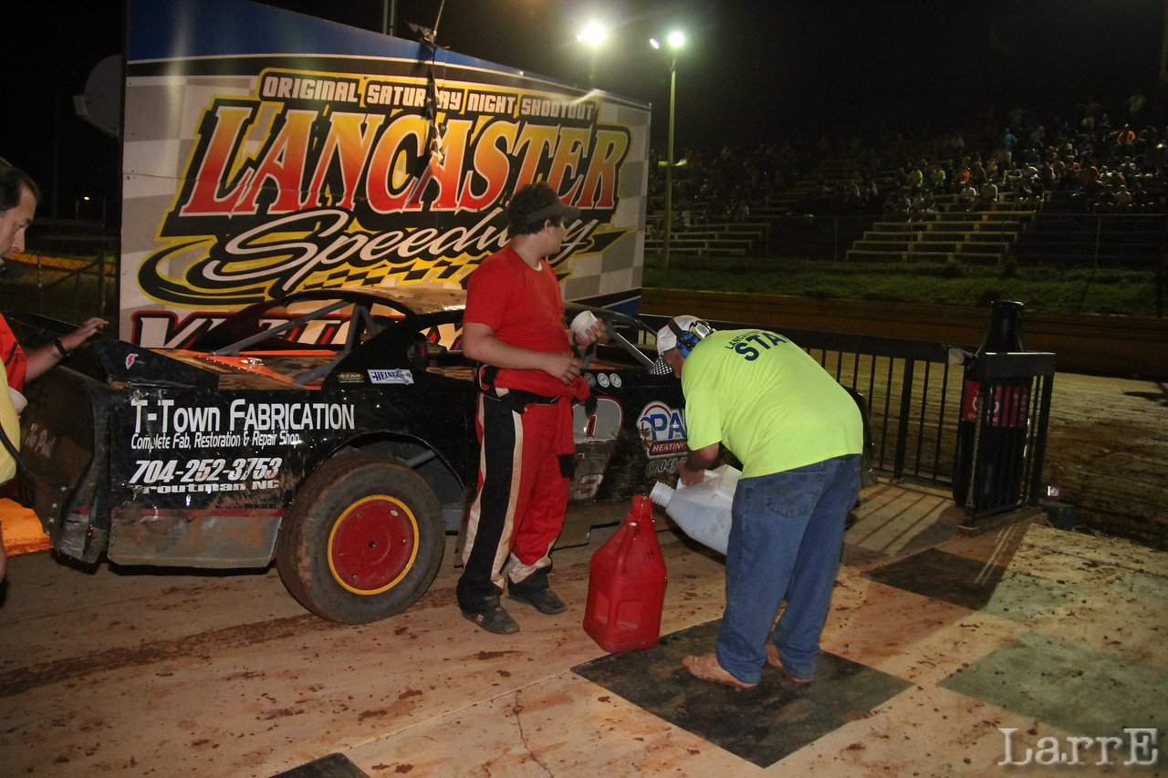 Buster Bell gives Hank Taylor his free 5 gallons of fuel. Thanks to Faith Funderburke Realty.