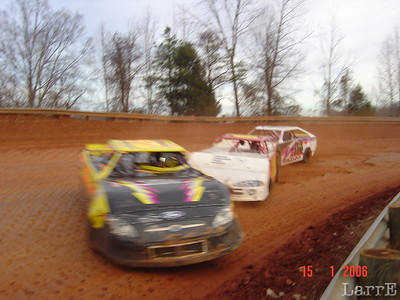 #58 Larry Teal starts to spin with help from #25 Donnie Brown and #114 Chris Cantrell