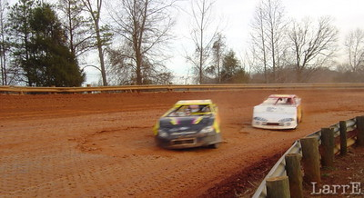 #58 Larry Teal leads #25 Ronnie Brown in Super Stock 4