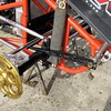 Torsion bar arm lays on top of the front axle