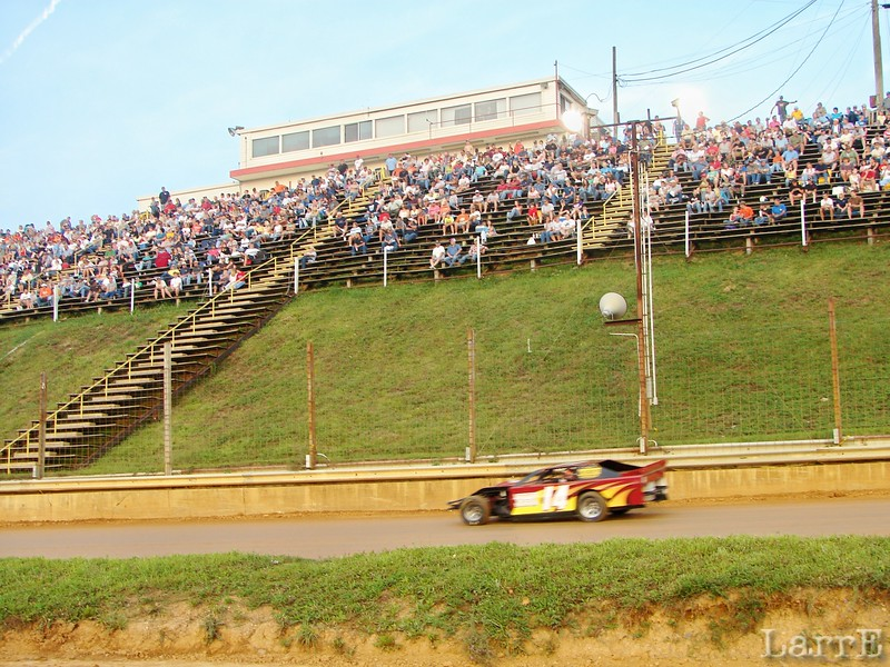 the crowd has a great view of the track