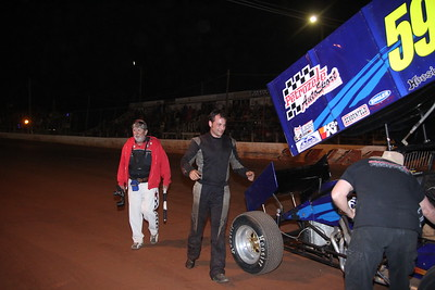 track photographer Jimmy Dimsdale chases after John for more pictures.