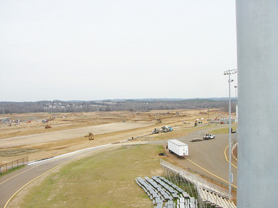Again the light colored area is probably a shared pit area (drag / dirt). The strip will run out into the cleared area in the distant trees. This view is looking northwest.