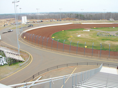 Turns 3 and 4 of the dirt track, with the end of the drag strip in the upper left.