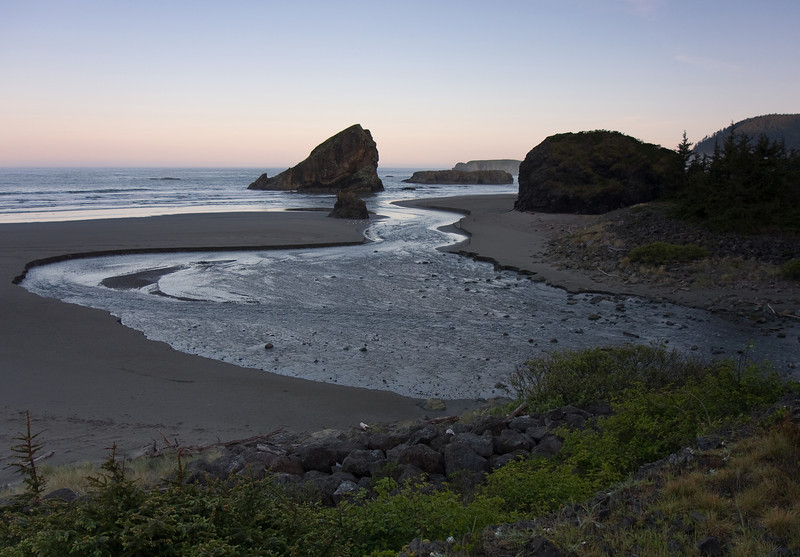 A pre-dawn shot of Myers creek flowing into the Pacific ocean.<br /> <br /> Location: Pistol River/Hunter's Cove area, southern Oregon coast<br /> <br /> Lens used: 17-55mm f2.8 IS w/2 stop Grad ND filter
