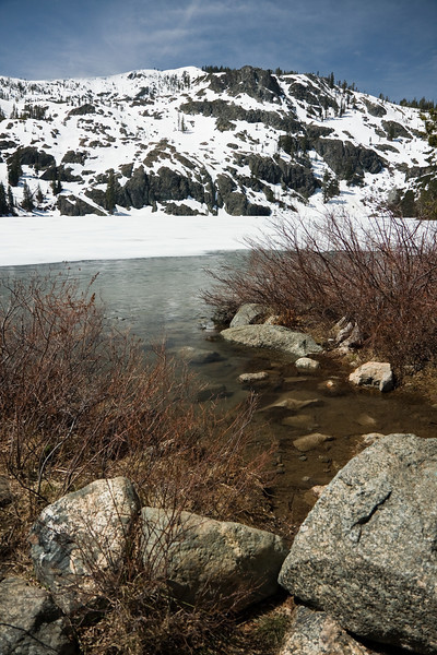 The lake was still mostly snowed-over with what little open water there was lightly frozen.  <br /> <br /> This area seems to always has residual snow - though this visit was in the first half of May, sometimes even much later in summer there is still snow covering the mountainside behind.  Not bad for an area that has seen much lighter snowfall in recent years than normal and is rightly concerned about drought.<br /> <br /> Location: Castle Lake.  Mt. Shasta, California<br /> <br /> Lens used: 17-55mm f2.8 IS