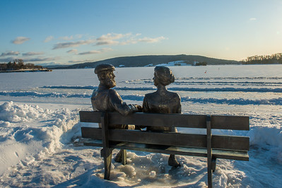 Bronze figures of Alexander Graham Bdell and his wife Mabel on the boardwalk at Baddeck beside the Bras d'Or Lake