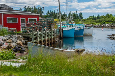 Fishing boats and wharf scenes at Moose Harbour in Queens County not far from the Town of Liverpool
