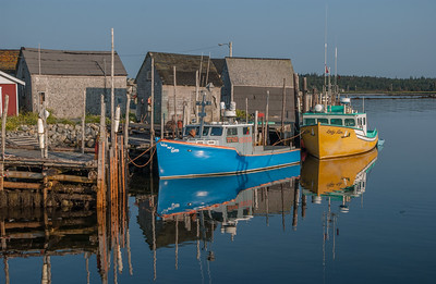 The fishing village and colourful fishing boats at West Berlin on the south shore of Nova Scotia is typical of the hundreds of fishing villages that dot the Nova Scotia coastline.