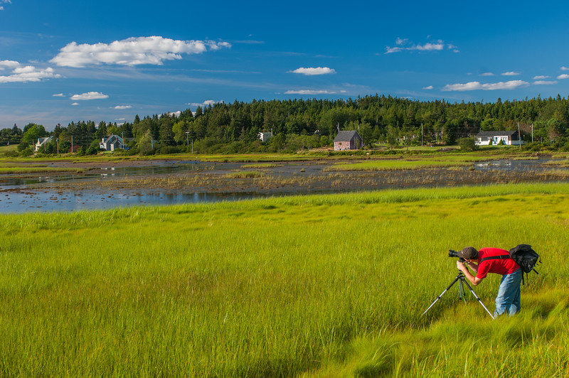 Photographer takes pictures on the salt marsh near Riverport at the mouth of the Lahave River in Lunenburg County