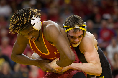 Action from NCAA Wrestling meet between the Iowa Hawkeyes and the Iowa State Cyclones at Hilton , Coliseum,  in Ames, Iowa on February 18, 2018. Photo by Wesley Winterink.
