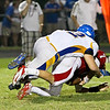Garner's #62 Tyler Starowicz chases down Middle Creek's #7 David Salmon for a sack as Garner runs over Middle Creek 46 to 29 Friday night September 7, 2012. (photo by Jack Tarr)