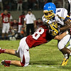 Garner's #2 Nyheim Miller-Hines breaks a tackle as Garner runs over Middle Creek 46 to 29 Friday night September 7, 2012. (photo by Jack Tarr)