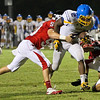 Garner's #2 Nyheim Miller-Hines breaks a tackle near the end zone as Garner runs over Middle Creek 46 to 29 Friday night September 7, 2012. (photo by Jack Tarr)