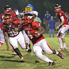 Middle Creek's #4 Devone Johnson runs around end as Garner runs over Middle Creek 46 to 29 Friday night September 7, 2012. (photo by Jack Tarr)