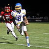 Garner's #8 Vincent Jefferies runs the ball as Garner runs over Middle Creek 46 to 29 Friday night September 7, 2012. (photo by Jack Tarr)