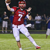 Middle Creek's #7 David Salmon passes the ball as Garner runs over Middle Creek 46 to 29 Friday night September 7, 2012. (photo by Jack Tarr)