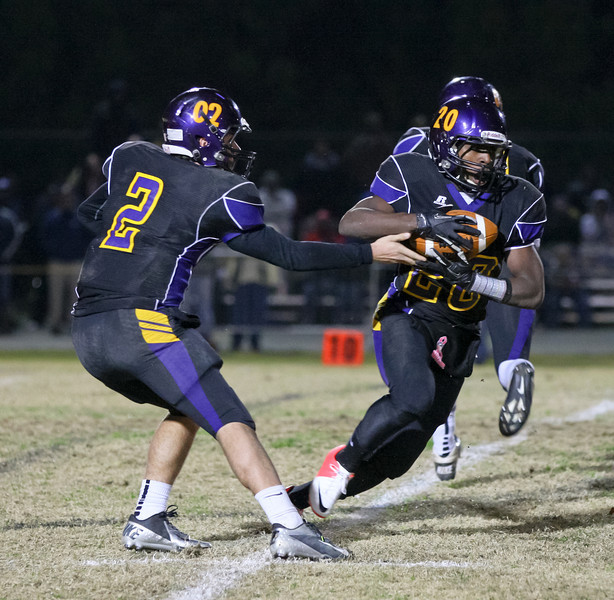 Carrboro's #20 Trai Sharp takes the hand off as Carrboro holds off Reidsville 20 to 16 in round 3 of the 2012 NCHSAA football playoffs Friday night November 16, 2012. (Photo by Jack Tarr)