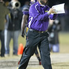 Carrboro head coach Jason Turdyn call in the play as Carrboro holds off Reidsville 20 to 16 in round 3 of the 2012 NCHSAA football playoffs Friday night November 16, 2012. (Photo by Jack Tarr)