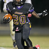 Carrboro's #20 Trai Sharp runs the ball as Carrboro holds off Reidsville 20 to 16 in round 3 of the 2012 NCHSAA football playoffs Friday night November 16, 2012. (Photo by Jack Tarr)