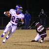 Wake Forest-Roleville's #22 Bryce Love runs the ball as Wakefield survives Wake Forest-Rolesville 40 to 38 in the first round of the 2012 NCHSAA football championship Friday night November 2, 2012. (Photo by Jack Tarr)