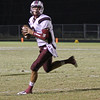 Wakefield's Connor Mitch (3) rolls out to pass. Wakefield tames Heritage 42 to 21 Friday night October 26, 2012. (Photo by Jack Tarr)