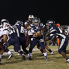 Heritage's Jordan Daniels (13) hands the ball off. Wakefield tames Heritage 42 to 21 Friday night October 26, 2012. (Photo by Jack Tarr)