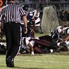 Heritage's Jordan Daniels (13) stretches but is just short of the goal line. Wakefield tames Heritage 42 to 21 Friday night October 26, 2012. (Photo by Jack Tarr)