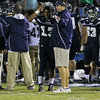 Heritage's Jordan Daniels (13) speaks with head coach Jason McGeorge. Wakefield tames Heritage 42 to 21 Friday night October 26, 2012. (Photo by Jack Tarr)