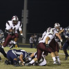 Wakefield's Phillip Cooley (11) leaps over a defender. Wakefield tames Heritage 42 to 21 Friday night October 26, 2012. (Photo by Jack Tarr)