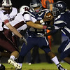 Heritage's Jordan Daniels (13) tries to hand the ball off. Wakefield tames Heritage 42 to 21 Friday night October 26, 2012. (Photo by Jack Tarr)