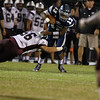 Heritage's Jordan Daniels (13) tries to run outside. Wakefield tames Heritage 42 to 21 Friday night October 26, 2012. (Photo by Jack Tarr)