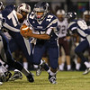 Heritage's Jordan Daniels (13) runs the ball. Wakefield tames Heritage 42 to 21 Friday night October 26, 2012. (Photo by Jack Tarr)