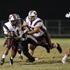 Wakefield's Phillip Cooley (11) runs the ball. Wakefield tames Heritage 42 to 21 Friday night October 26, 2012. (Photo by Jack Tarr)