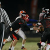 Nick Harvilla (13) gets the hand off as Middle Creek crushes Athens Drive 56 to 21 Friday night October 25, 2013. (photo by Jack Tarr 2013)