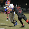 Jerrell Thorpe (34) runs the ball as Middle Creek crushes Athens Drive 56 to 21 Friday night October 25, 2013. (photo by Jack Tarr 2013)