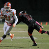 Scott Baird (21) runs the ball as Middle Creek crushes Athens Drive 56 to 21 Friday night October 25, 2013. (photo by Jack Tarr 2013)