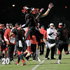Middle Creek celebrates another touchdown as Middle Creek crushes Athens Drive 56 to 21 Friday night October 25, 2013. (photo by Jack Tarr 2013)