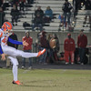 Ben Williams (40) punts the ball as Middle Creek crushes Athens Drive 56 to 21 Friday night October 25, 2013. (photo by Jack Tarr 2013)